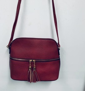 Reddish brown with tassells purse